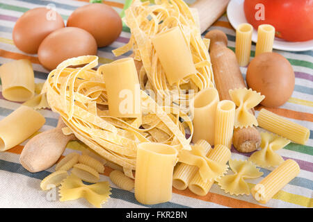mix of handmade pasta with egg tagliatelle and other - Stock Photo