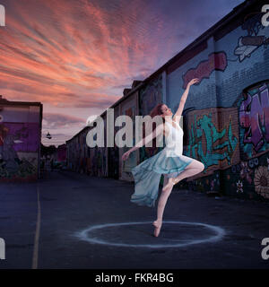 Caucasian ballerina dancing in circle - Stock Photo