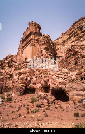 Tombs and caves in the red rock lost city of Petra, Hashemite Kingdom of Jordan, Middle East. - Stock Photo