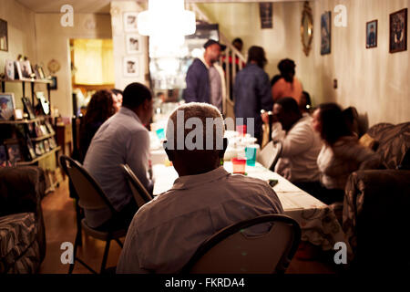 Family eating dinner at table - Stock Photo
