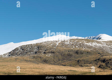 Yr Wyddfa or Snowdon mountain with Bwlch Main to the right - Stock Photo