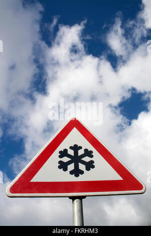 Warning of frost on the road. - Stock Photo