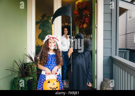 Children trick-or-treating on Halloween - Stock Photo