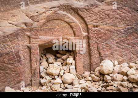 A small cave opening in the narrow siq passage entrance to Petra, Hashemite Kingdom of Jordan. - Stock Photo
