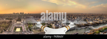 Drone flying above Paris city panorama - Stock Photo