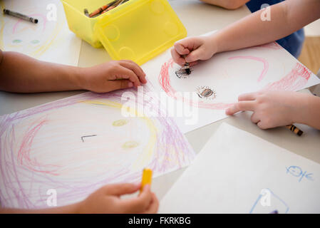 Students drawing in classroom - Stock Photo