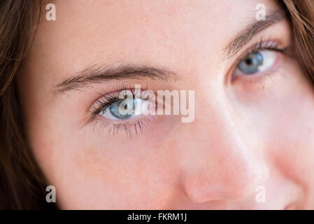Close up of eyes and nose of Native American woman - Stock Photo