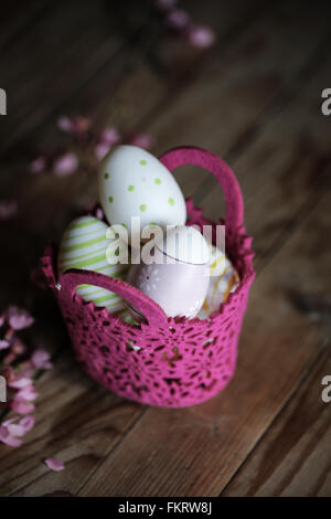 Decorated egg in a basket - Stock Photo