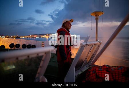 Mytilini, Greece. 10th Mar, 2016. Timo Jobt steers the rescue cruiser Minden at the harbopur of Mytilini, Greece, - Stock Photo