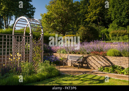 Tunnel arbour and in beautiful, designed, landscaped, traditional garden, Burley-in-Wharfedale, West Yorkshire, - Stock Photo