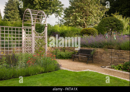 Recently designed and landscaped, a beautiful, traditional garden with arbour and borders, in summer - Burley-in - Stock Photo
