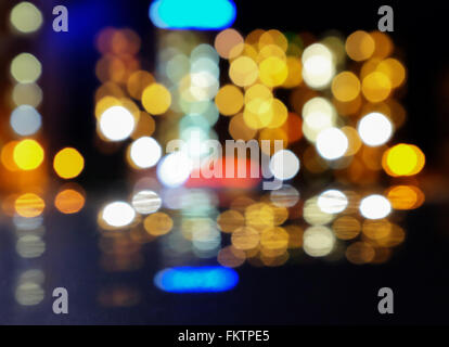 Artistic style - Defocused urban abstract texture ,bokeh of city lights in the background with blurring lights - Stock Photo