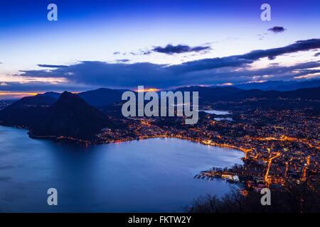 High angle view of Lake Lugano at dusk, Switzerland - Stock Photo