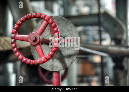 Old style valves in heavy industry  factory in Gondang Baru, Indonesia - Stock Photo