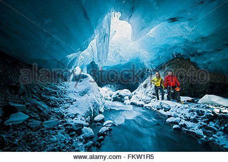 Portrait of two men in ice cave below the Gigjokull glacier, Thorsmork, Iceland - Stock Photo