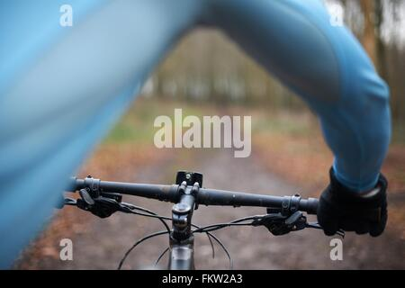 Close up of cyclist and handlebars of bike - Stock Photo
