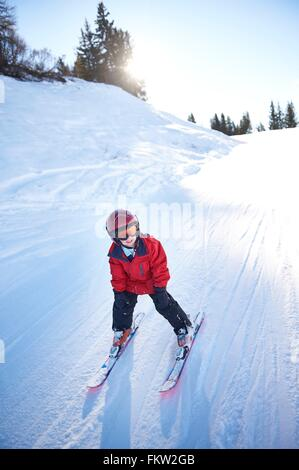 Young skier going downhill - Stock Photo