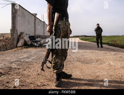 SYRIA. MARCH 10, 2016. Abu Juma, leader of Jaysh al-Thuwar (back), speaking on the phone near the town of Azaz. - Stock Photo