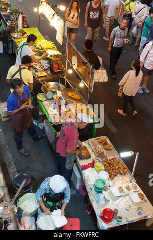 On Sunday, Bangkok street cooking at Sala Daeng (Thailand). The slightest patch of pavement is taken up by food - Stock Photo