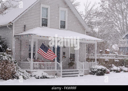 Large American Flag On An Old Victorian House In New