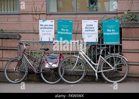 Posters supporting striking junior doctors outside the Bristol Royal Infirmary in Bristol, England on 10 March 2016. - Stock Photo
