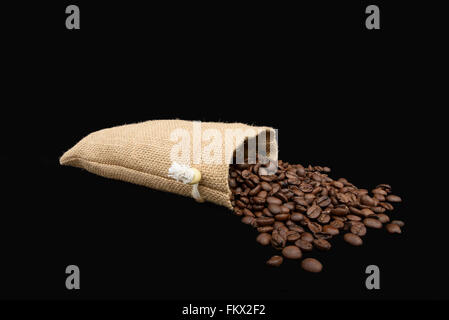 Coffee Beans in burlap sack. - Stock Photo
