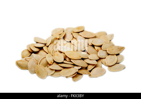Pumpkin seeds isolated in white - Stock Photo