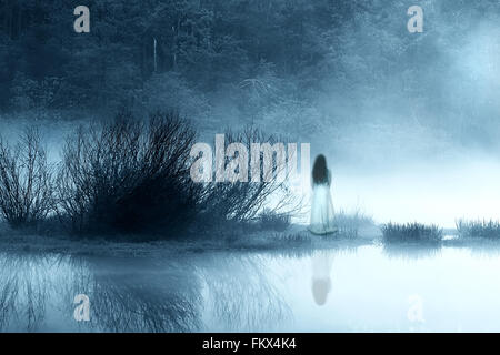 Mysterious Woman in the Mist - Stock Photo