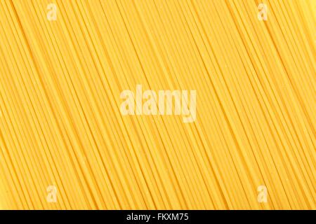 Full background of dry uncooked spaghetti pasta - Stock Photo