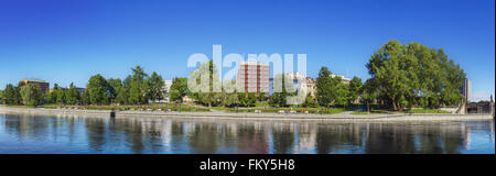 TAMPERE, FINLAND - JUNE 2012: Panorama of Tampere river with hotels and office buildings in the background on June - Stock Photo