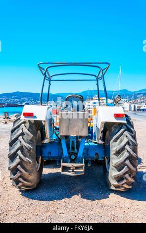 Old tractor in Agios Nikolaos, Crete, Greece. - Stock Photo