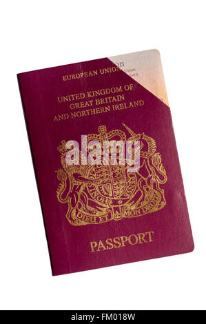 An expired and cancelled UK passport with one corner cut off. - Stock Photo