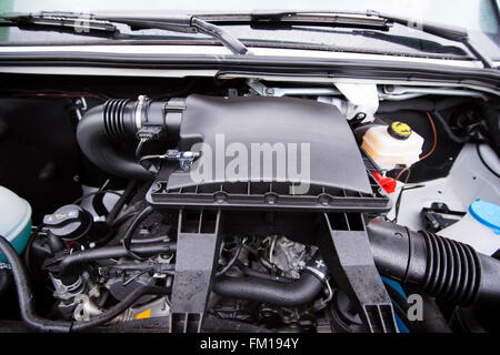 Compact powerful and economical diesel engine under the hood of a cargo van. A lot of aluminum parts, metal and - Stock Photo