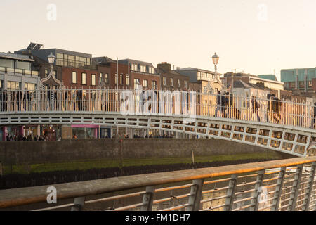 Ha'penny bridge, over the River Liffey at sunset, Dublin, Ireland - Stock Photo