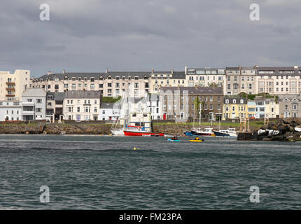 Houses and accommodation overlooking boats in Portrush Harbour at Portrush, County Antrim, Northern Ireland - Stock Photo