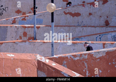 A religious Jewish pedestrian descending a staircase in Safed also spelled Zefat Tsfat Zfat or Tzfat the highest - Stock Photo