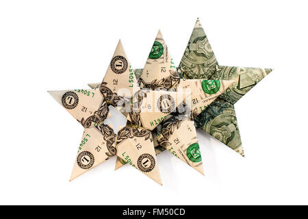 Three different variants of cash dollar bills stacked in the shape of the stars folded in a row one by one as stars - Stock Photo