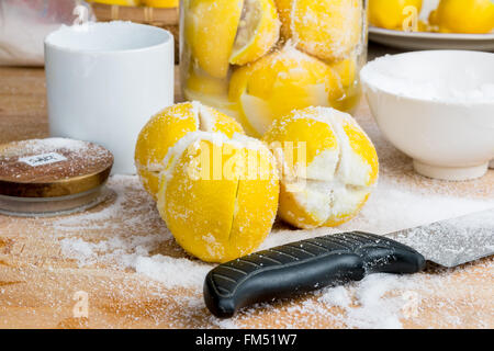 The tools for making preserved Moroccan lemon, lemons, salt, knife, container - Stock Photo