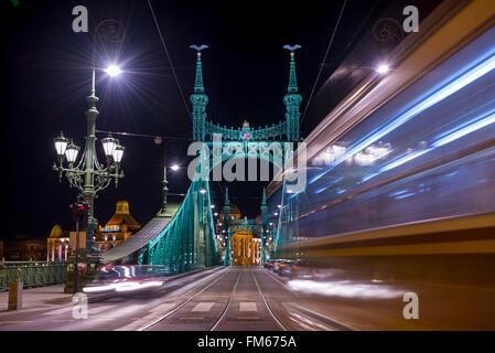 Liberty bridge and tram in Budapest Hungary - Stock Photo