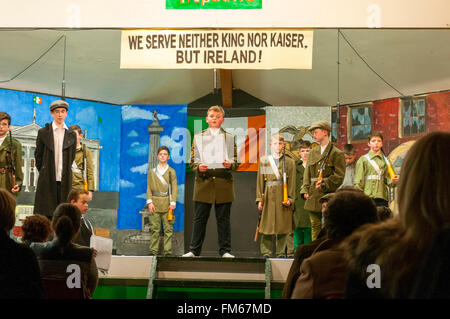 School children in Dungloe, County Donegal, Ireland perform a play entitled 'Remembering Easter 1916' as part of - Stock Photo