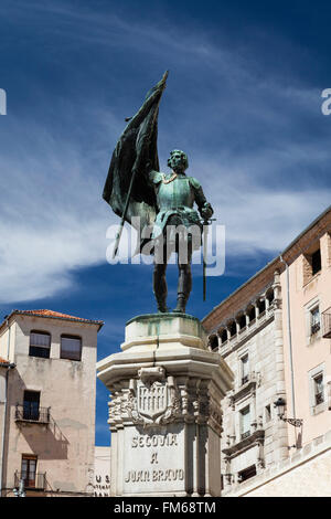 A view from below the bronze statue of Juan Bravo, stood on a plinth with sword and flag in Segovia in Spain. - Stock Photo