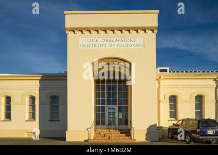 The exterior of a large yellow building with an imposing entrance, that is the University of California lick observatory. - Stock Photo