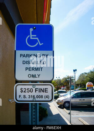 Warning sign at a disabled bay (mis-spelled) warning that only permit holders can use it. - Stock Photo