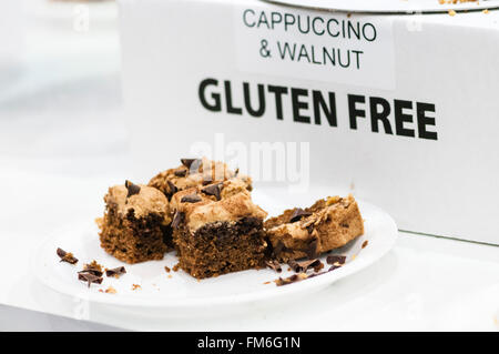 Gluten Free Cappuccino and Walnut Cake on sale in an up-market cafe. - Stock Photo