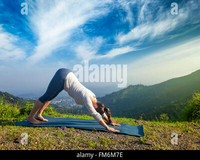 Woman doing yoga oudoors in mountains - Stock Photo