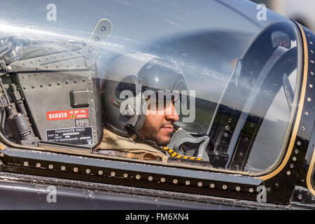 Pilot of the Al Fursan aerobatics display team from the United Arab Emirates Air Force in the cockpit of an Aermacchi - Stock Photo