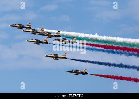 Al Fursan, the aerobatics team of the United Arab Emirates Air Force perform in their Aermacchi MB-339NAT jet trainer - Stock Photo