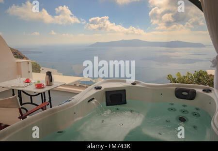 View from hot tub on balcony overlooking the Aegean sea on Santorini - Stock Photo