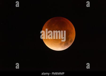 Lunar Eclipse, Red supermoon, Blood moon / Blutmond, 28th September 2015, sparkling stars around, detailed shot. - Stock Photo