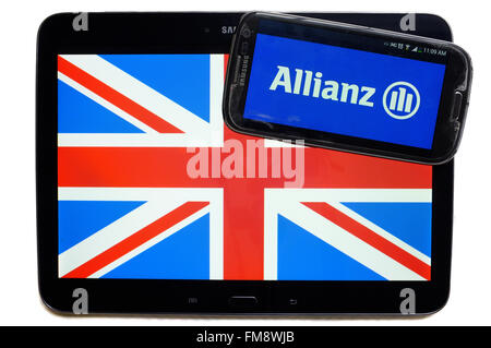 The Union Jack on a tablet and the logo of Allianz on a smartphone against a white background. - Stock Photo